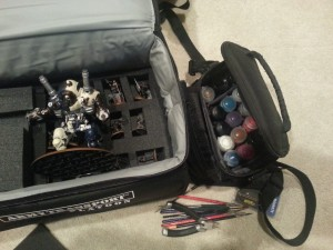 The nice thing about warmachine is that my 50 point army all fit into one case.  I brought my full paint, files, glue, etc. in case I had a hobby emergency or got in the mood to do some work.